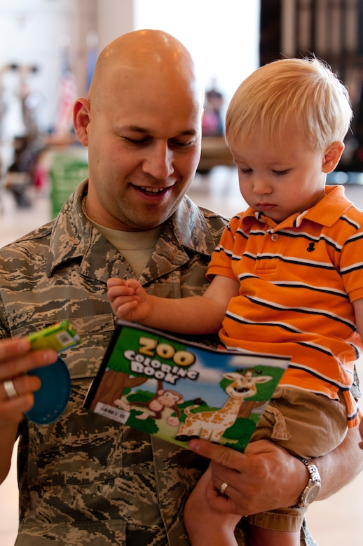 "The 133rd Airlift Wing held its annual family day Sept. 15, 2012 St. Paul, Minnesota the event was officially kicked off in the Wing's north hanger by Wing Commander Colonel Greg A. Haase, as he shared some details about the past year of the Wing and its future. Events for children and family members included a fish pond, archery, climbing wall, hay ride, bean bag toss, hammer bell, bouncing room, hay rides, and a home run derby. The static display of one of the Wing's C-130 ""Hercules"" cargo aircraft on the flightline always one of the most popular attractions for families to explore. Food was provided free of charge and served by Fat Lorenzo's of Minneapolis to the Airmen and their families. Air Force by Tech. Sgt. Erik Gudmundson/released"
