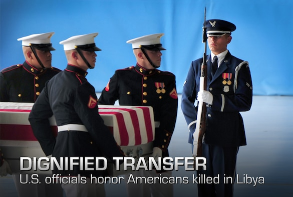 A U.S. Air Force Honor Guard ceremonial guardsman presents arms during a dignified transfer ceremony at Joint Base Andrews, Md., Sept. 14, 2012. Ceremonial guard members from all branches of the Department of Defense worked jointly to honor U.S. Foreign Service members killed during attacks to the U.S. consulate Sept. 11, 2012, in Benghazi, Libya. (U.S. Air Force photo/Senior Airman Steele C. G. Britton)