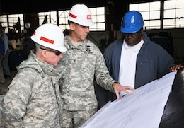 "Maj. Gen. Merdith W.B. ""Bo"" Temple (left), former deputy commander of the U.S. Army Corps of Engineers, discusses blueprints for the ladder extension project of the dredge ""Hurley"" with Col. Tom Smith, commander of Memphis District, and Curtis Pigram, metal worker and welder lead"