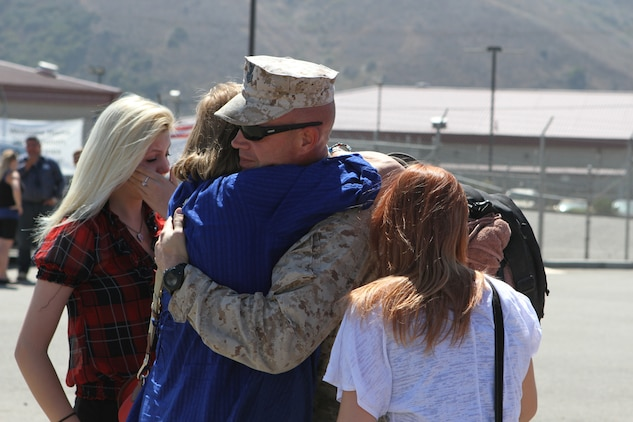 Petty Officer 1st Class Nathan Hardin, an independent duty corpsman serving with 2nd Battalion, 5th Marine Regiment, reunites with his family after returning home Sept. 17, 2012, from a deployment to Afghanistan. Hardin, an Escondido, Calif., native, treated Marines at the battalion aid station, a medical component within 2nd Bn., 5th Marines? Headquarters and Service Company. More than 1,100 Marines and sailors serving with the battalion returned from a seven-month deployment to northern Helmand province, Afghanistan.
