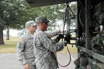 Sgt. Joshua Deisinger and Sgt. David Herman, 724th Engineer Batallion, complete operations after refueling a vehicle during PATRIOT 12. The refueling section of Company A, 724th Engineer Battalion of Hayward conducted round-the-clock refueling missions, supporting the whole PATRIOT 12 exercise, for equipment used during the exercise. The operation was part of PATRIOT 12, a National Guard domestic response exercise that included both military and civilian agencies. Wisconsin National Guard photo by Sgt. Robert Waight