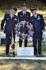 """Chief Master Sgt. Jeffrey Neitzel, Capt. John O'Brien and Col. Gary Ebben place a wreath at the memorial marker of 1st Lt. Jerome Volk during a July 11 memorial service at Volk Field. The service rendered final respects and honors to the base's namesake, the first Wisconsin Air National Guard pilot to die in the line of duty during the Korean conflict. Volk was shot down during a combat sortie against communist forces Nov. 7, 1951, and his remains have never been recovered. In 1957 the Wisconsin legislature renamed the portion of Camp Williams used by the Wisconsin Air National Guard as Volk Field. Don Volk, 1st Lt. Volk's younger brother and next of kin, and dozens of other relatives attended the ceremony, which included full military honors such as a color guard, rifle squad, and a """"missing-man formation"""" F-16 fly-over. Wisconsin National Guard photo by 1st Sgt. Vaughn R. Larson"""