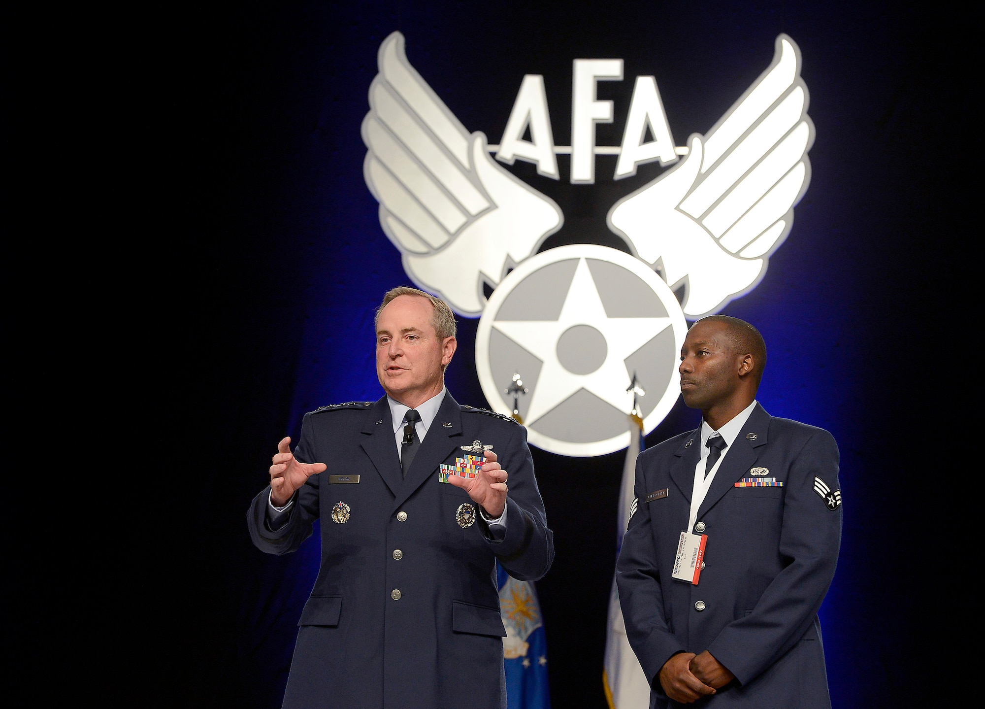 Air Force Chief of Staff Gen. Mark A. Welsh III introduces Senior Airman Shemiel Christopher for his work at the Dover Air Force Base, Del., Fisher House during his keynote presentation on the state of the Air Force at the Air Force Association's Air and Space Conference and Technology Exposition in Washington, D.C., Sept. 18, 2012.   (U.S. Air Force photo/Scott M. Ash)