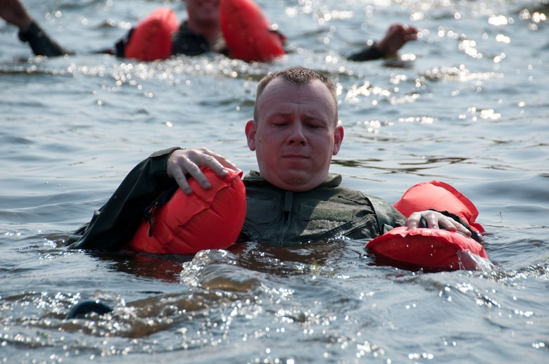 A member of the 133rd Airlift Wing is taking part in water survival training at the Army Training Site Arden Hills, Minnesota Sept. 16, 2012. The airman is using an LPU-10P air crew life preserver to swim towards the safety of the life raft. U.S. Air Force photo by Airman 1st Class Kari L. Giles/released