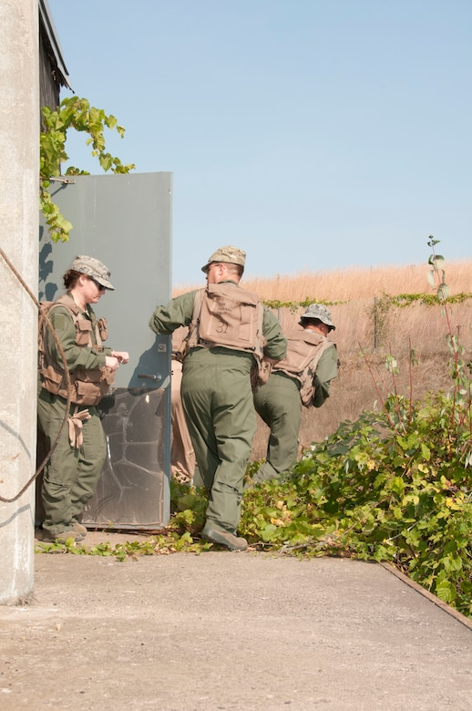 Members of the 133rd Airlift Wing are taking part in survival, evasion, resistance, and escape (SERE) training at the Army Training Site Arden Hills, Minnesota Sept. 16, 2012. The captured airmen are escaping from the holding cells, running towards the shelter of the woods.  U.S. Air Force photo by Airman 1st Class Kari L. Giles/released