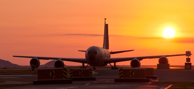 ALTUS AIR FORCE BASE, Okla. – The sun rises behind a KC-135 Stratotanker on the flight line Sept. 18, 2012. The mission at Altus AFB is to train KC-135 pilots and boom operators as well as C-17 Globemaster III pilots and loadmasters. (U.S. Air Force photo by Senior Airman Kenneth W. Norman / Released / 97th Air Mobility Wing Public Affairs)