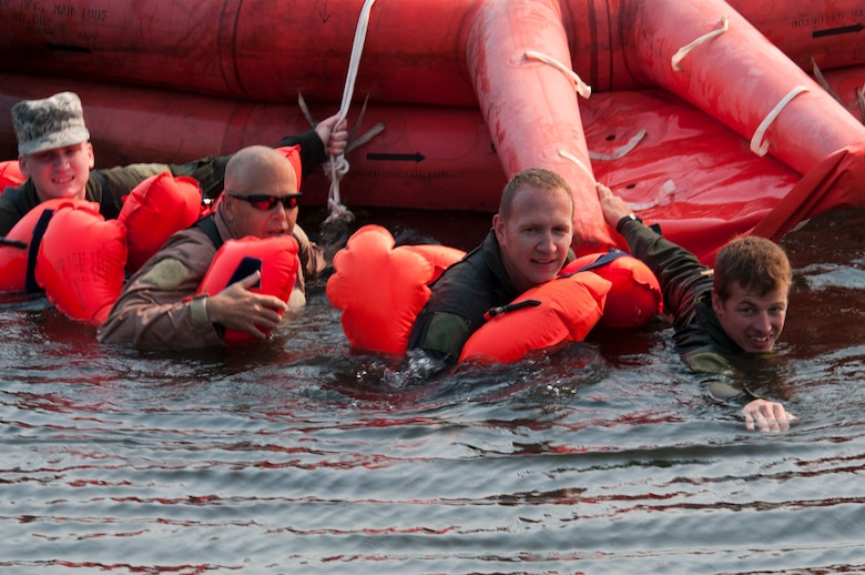 Airmen of the 133rd Airlift Wing are taking part in survival, evasion, resistance, and escape (SERE) training and water survival training including: lift raft familiarization, parachute disentanglement and rescue techniques.at the Army Training Site Arden Hills, Minnesota Sept. 16, 2012. Here a group of Airmen finsh the day by pulling the survival raft ashore. U.S. Air Force photo by Tech. Sgt. Erik Gudmundson/released