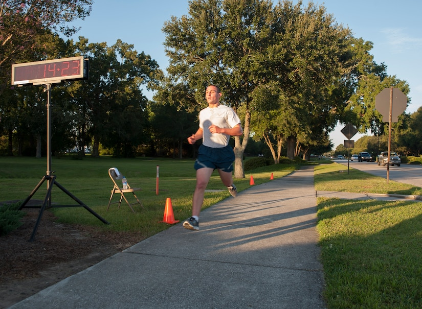 Airman Basic Steven Gray, 373rd Training Squadron Det. 5, was the fastest male runner with a time of 14:23 during the 2.37-mile 100th Commander's Challenge Run at Joint Base Charleston - Air Base, Sept. 14, 2012. (U.S. Air Force photo/Airman 1st Class Ashlee Galloway)