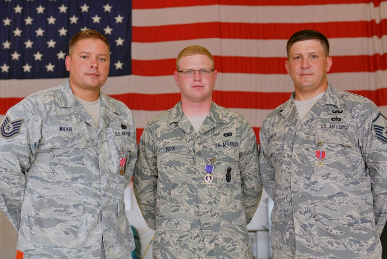 (left to right) Bronze Star recipient Technical Sgt. Charles Wilkie Jr., Purple Heart recipient Senior Airman Sean Parr, and Bronze Star recipient Master Sgt. Raleigh Rogers, stand for a photo following an awards ceremony in their honor, August 19, 2012, 125th Fighter Wing, Florida Air National Guard, Jacksonville, Fla. (Air National Guard photo by Master Sgt. Shelley Gill)
