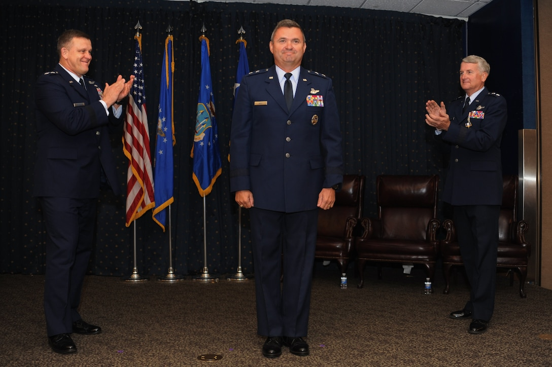 From the left: Assistant Vice Chief of Staff of the Air Force Lt. Gen. Frank Gorenc leads the applause for new Air Force Operational Test and Evaluation Commander Maj. Gen. Scott D. West joined by departing AFOTEC Commander Maj. Gen. David J. Eichhorn during a Sept. 13 change of command ceremony at Kirtland Air Force Base, N.M. (U.S. Air Force photo/Ken C. Moore)