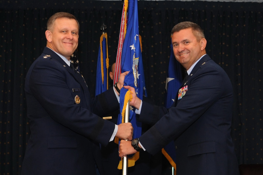 Maj. Gen. Scott D. West accepts command of the Air Force Operational Test and Evaluation Center from Assistant Vice Chief of Staff of the Air Force Lt. Gen. Frank Gorenc during a change of command ceremony at Kirtland Air Force Base, N.M. (U.S. Air Force photo/Ken C. Moore)