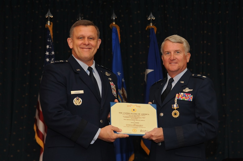 Assistant Vice Chief of Staff of the Air Force Lt. Gen. Frank Gorenc presents the Distinguished Service Medal to Maj. Gen. David J. Eichhorn, departing Air Force Operational Test and Evaluation Center commander during the Sept. 13 change of command ceremony. (U.S. Air Force photo/Ken C. Moore)