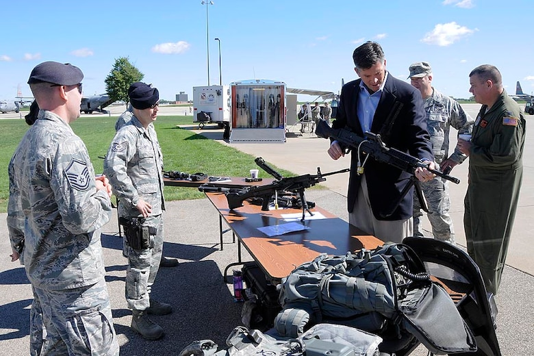 Illinois State Senator Darin LaHood handles a rifle at a Security Forces static display at the 182d Airlift Wing in Peoria, Ill. on Sep. 8, 2012. (U.S. Air Force photo by Tech Sgt. Todd Pendleton/Released).