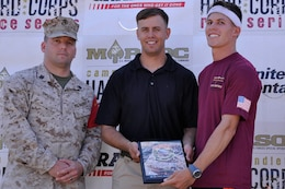 Cpl. Samuel C. Brandt, a radio operator with 1st Intelligence Battalion, receives an award for being a first place finisher during the Heartbreak Ridge Half Marathon at Camp Pendleton's 43 Area Parade Deck, Spet. 8.