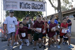 Youth athletes dash through the starting line during the Heartbreak Ridge Half Marathon at Camp Pendleton's 43 Area Parade Deck, Sept. 8.