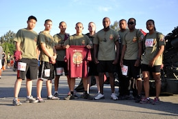 Marines from Headquaters and Support Battalion's installation personnel administration center (14 area remote), gather for a team photograph before running the Heartbreak Ridge Half Marathon at Camp Pendleton's 43 Area Parade Deck, Sept. 8.