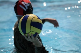 A player prepares to pass the ball during a combat water polo tournament at Camp Pendleton's 13 Area Pool, Sept. 12. Marine Corps Community Services' Pendleton Cup Series provided Marines and sailors with an opportunity to build unit cohesion and camaraderie while competing for monetary prizes that will be awarded to their respective units.