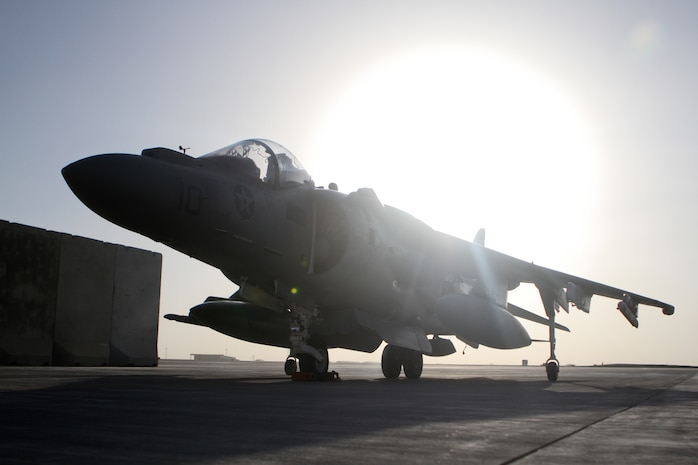 An AV-8B Harrier II Plus with Marine Attack Squadron 211, 3rd Marine Aircraft Wing (Forward), awaits its next mission on the tarmac at Camp Bastion, Afghanistan, Sept. 18, 2012. The aircraft provides air support to the ground units throughout Helmand and Nimroz provinces. Despite a roller coaster week for the squadron, VMA-211 remains fully operational and continues to provide support to ground troops throughout Regional Command Southwest?s area of operations.