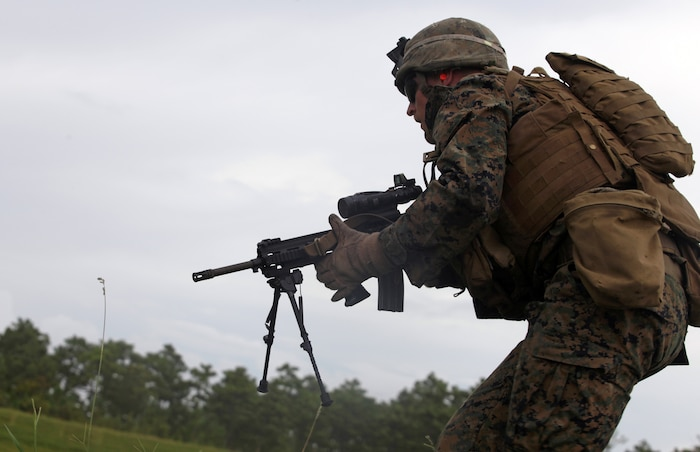 Lance Cpl. Tyler Stoneman, a fireteam leader with 1st Battalion, 6th Marine Regiment, maneuvers toward a trench during a training exercise as part of the Forge Academy Sept. 18. The Forge Academy is an approximately four-week long course designed to improve the proficiency of 1/6?s fireteam leaders. Throughout the course, the students were educated on troop welfare, the psychological and physiological effects of combat, infantry tactics and the responsibilities of being a fireteam leader.