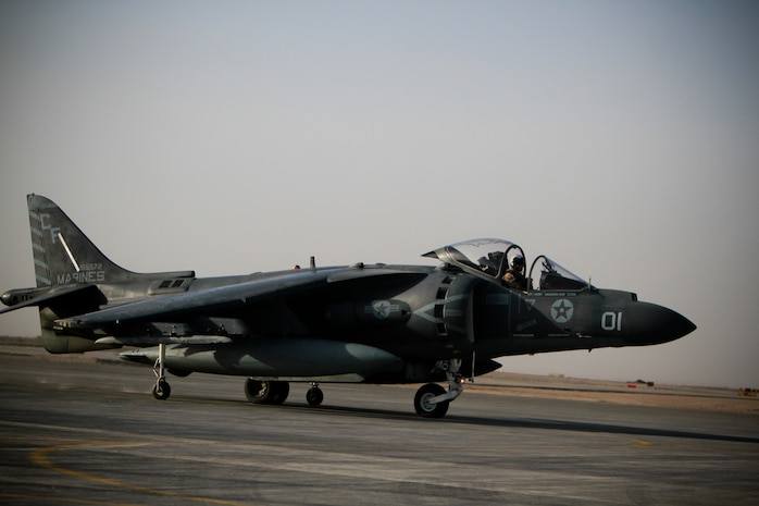 Capt. Matthew Pasquali, a pilot with Marine Attack Squadron 211, 3rd Marine Aircraft Wing (Forward), maneuvers his AV-8B Harrier II Plus into a parking spot, Sept. 18. The squadron operates throughout Helmand and Nimroz province. They are part of the fixed wing attack asset of the Marine Air-Ground Task Force.