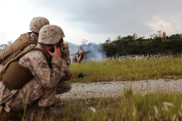 Marines observe the firing of a shoulder-launched multipurpose assault weapon on Camp Schwab Sept. 19. Marines participated in a two-day weapons training event, which included firing the M249 squad automatic weapon, M240B medium machine gun, MK19 40 mm grenade launcher, .50?caliber Browning heavy machine gun and the SMAW. Lance Cpl. Colby T. Jones is a combat engineer squad automatic weapon with 9th Engineer Support Battalion, 3rd Marine Logistics Group, III Marine Expeditionary Force.