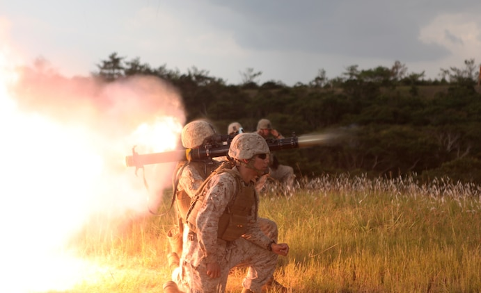 Marines fire a shoulder-launched multipurpose assault weapon on Camp Schwab Sept. 19. Marines participated in a two-day weapons training event, which included firing the M249 squad automatic weapon, M240B medium machine gun, MK19 40 mm grenade launcher, .50?caliber Browning machine gun and the SMAW. Lance Cpl. Colby T. Jones is a combat engineer squad automatic weapon with 9th Engineer Support Battalion, 3rd Marine Logistics Group, III Marine Expeditionary Force.