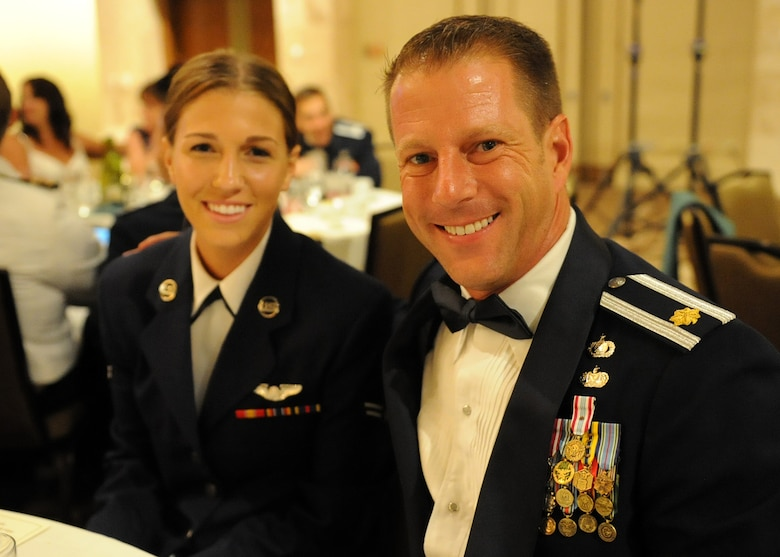 Maj. Jeffrey Holley, Pacific Air Forces A7K chief of strategic integration, and his daughter Airman 1st Class Samantha Holley, a C-17 loadmaster with the 535th Airlift Squadron, pose for a photo during the Joint Base Pearl Harbor-Hickam 65th Air Force Ball, held at the Hilton Hawaiian Village Sept. 14, 2012.  Maj. Holley invited his daughter as his date to the ball shortly after discovering that he would be stationed at JBPH-H, Hawaii with her. (U.S. Air Force photo/Tech. Sgt. Jerome S. Tayborn)