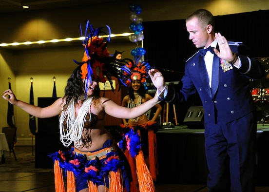 A Hawaiian performer dances center stage with an audience member at the Joint Base Pearl Harbor-Hickam 65th Air Force Ball at the Hilton Hawaiian Village Sept. 14, 2012. The ball celebrated the Air Force's 65th year as a separate service and paid tribute to the heroes that have served throughout history. (U.S. Air Force photo/Tech. Sgt. Jerome S. Tayborn)