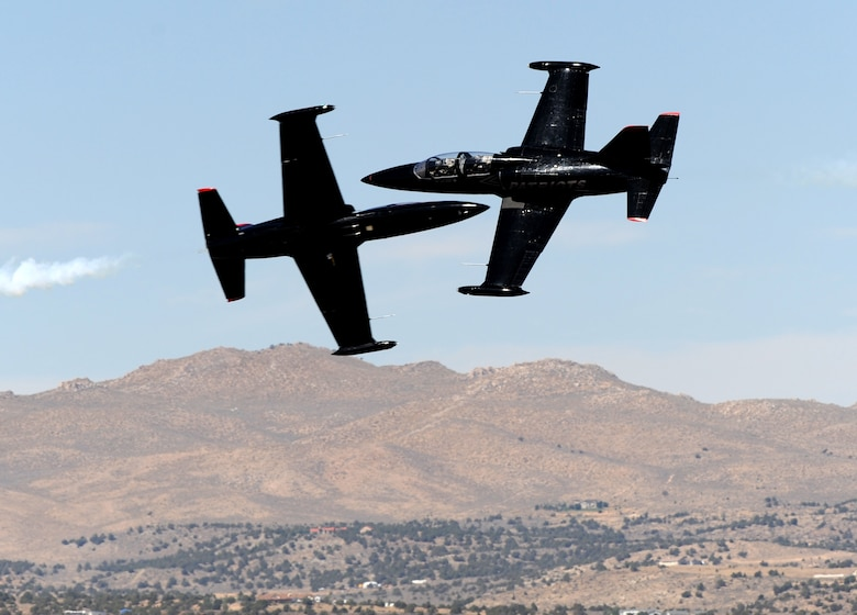 Two L-39 Albatrosses from the Patriots Jet Demonstration Team perform opposing high-speed passes during the National Championship Air Races at Stead Airport, Reno, Nev., Sept. 14, 2012. The Patriots are civilian-owned jet aerobatic team. (U.S. Air Force photo by Staff Sgt. Robert M. Trujillo)