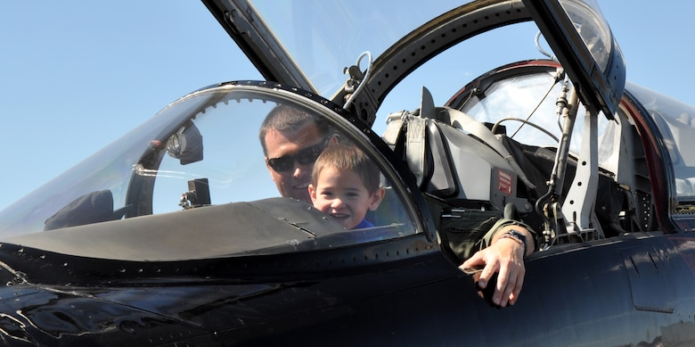 A child becomes a pilot-for-a-day in an Air Force T-38 Talon trainer aircraft during the National Championship Air Races at Stead Airport, Reno, Nev., Sept. 14, 2012. The Talon is primarily used by Air Education and Training Command for joint specialized undergraduate pilot training. (U.S. Air Force photo by Staff Sgt. Robert M. Trujillo/Released)