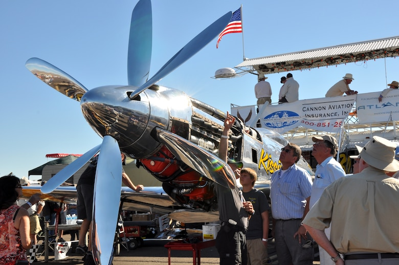 A pilot explains propeller modifications to his P-51 Mustang fighter aircraft during the National Championship Air Races at Stead Airport, Reno, Nev., Sept. 14, 2012. The air races have been held annually since 1963. (U.S. Air Force photo by Staff Sgt. Robert M. Trujillo/Released)