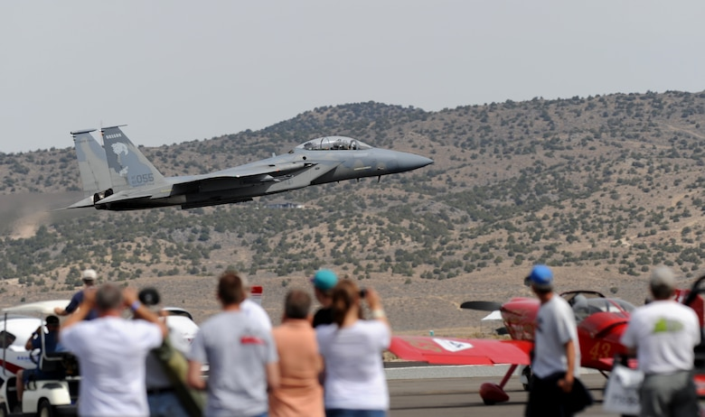 A U.S. Air Force F-15 Eagle fighter aircraft flies by a group of spectators during the National Championship Air Races at Stead Airport, Reno, Nev., Sept. 14, 2012. The aircraft is from the 114th Fighter Squadron, Oregon Air National Guard. (U.S. Air Force photo by Staff Sgt. Robert M. Trujillo/Released)