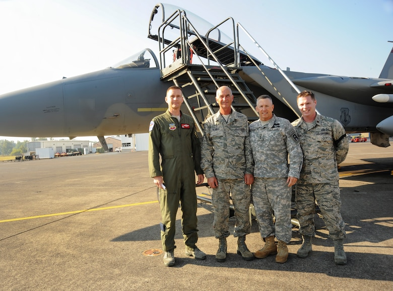 U.S. Army Lt. Gen. Mick Bednarek, Commanding General First U.S. Army, stands with members of the 142nd Fighter Wing and one of the unit's F-15C Eagles, during his visit to the Portland Air National Guard Base, Portland, Ore., Sept. 14, 2012.  Image pictured (from left to right) Oregon Air National Guard Col. Rick Wedan, Vice Commander 142nd Fighter Wing, Master Sgt. Mark Billmyer, Crew Chief, Lt. Gen. Bednarek, and Maj. Brian Kroller, Intelligence Officer for the 142nd Fighter Wing. (U.S. Air Force photograph by Tech. Sgt. John Hughel, 142nd Fighter Wing Public Affairs Department) (Released)