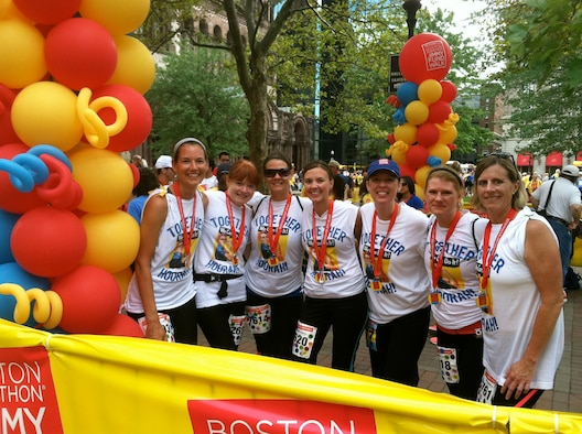 BOSTON — (from left to right) Heather Potter, Samantha McMenamy, Rebecca Alonso, Heather Julseth, Michele Gish, Michal Holl and Barb Hiltz, all members of The Real Housewives of Hanscom, gather together after walking 26.2 miles at the Jimmy Fund Walk in Boston Sep. 9. More than 7,500 walkers participated in the event that supports the fight against cancer in children and adults at Boston's Dana-Farber Cancer Institute. (Courtesy photo)