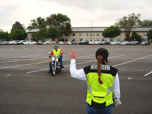 Michael Ballard, Air Force Ground Safety Operations Branch chief, operates a motorcycle per instructions of Master Sgt. Bonnie Steinmetz, an instructor candidate, during the Motorcycle Safety Foundation's RiderCoach Preparatory Training course held Sept. 7-13 at Kirtland AFB, N.M. (U.S. Air Force photo by Mike Wolcott)