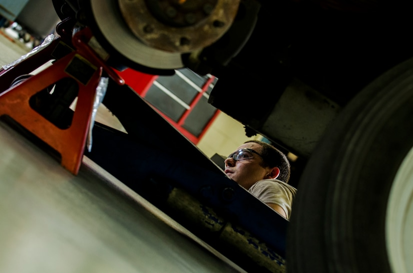 Senior Airman Benjamin Kingston, 628th Logistics Readiness Squadron vehicle maintenance technician, checks a vehicle's brake system during a routine inspection Sept. 6, 2012, at Joint Base Charleston - Air Base, S.C. Vehicle maintenance technicians maintain JB Charleston's entire vehicle fleet, keeping cars, trucks and buses operating smoothly. (U.S. Air Force photo/Airman 1st Class George Goslin)
