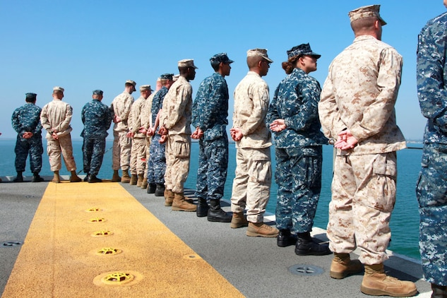 Marines and sailors with the 15th Marine Expeditionary Unit and USS Peleliu man the rails of the USS Peleliu Sept. 17.  The MEU embarked the ships of the Peleliu Amphibious Ready Group and pulled away from the pier at Naval Base San Diego for its deployment to the Western Pacific.