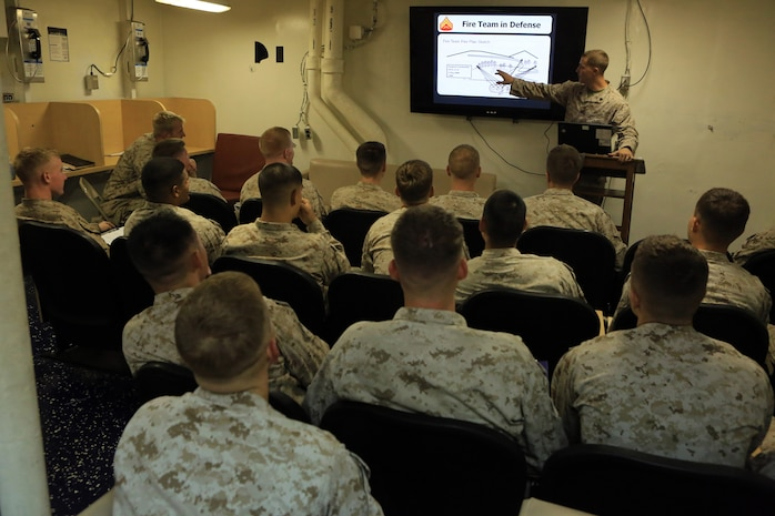 Corporals with the 24th Marine Expeditionary Unit receive a class on infantry tactics aboard the USS Gunston Hall in the Gulf of Aden, Sept. 19. The class was part of a command-sponsored Corporal's Course that took place both ashore in Kuwait and aboard the ship. The 24th MEU is deployed with the Iwo Jima Amphibious Ready Group as a theater reserve force for U.S. Central Command and is providing support for maritime security operations and theater security cooperation efforts in the U.S. Navy's 5th Fleet area of responsibility.