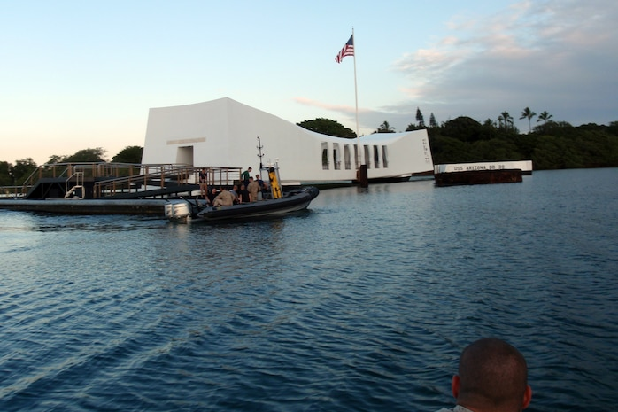 Marines with Reconnaissance Platoon, Battalion Landing Team 3/5, 15th Marine Expeditionary Unit, and Force Reconnaissance Platoon, 15th MEU, arrive at the USS Arizona Memorial before diving to see the sunken vessel, Sept. 19. The swift, silent and deadly divers used the time to sharpen their skills and qualify for some of the unique missions the Marines could be called upon to conduct during the deployment. They viewed USS Arizona Memorial from a unique vantage point of the and simultaneously earned an open-circuit dive qualification. An open-circuit dive is similar to recreational diving since the Marines use oxygen tanks.