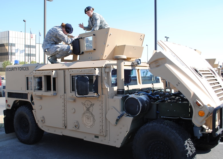 Airmen 1st Class Ella Cates, left, and Sarah Romberger, both 741st Missile Security Forces Squadron Convoy Response Force members, prepare one of the new 2012 Up-Armored Humvees on Sept. 18 for a trip to the missile complex the following day.  This vehicle is one of the first of 76 new Humvees that will become mission ready over the next few months.  (U.S. Air Force photo/Airman 1st Class Cortney Paxton)