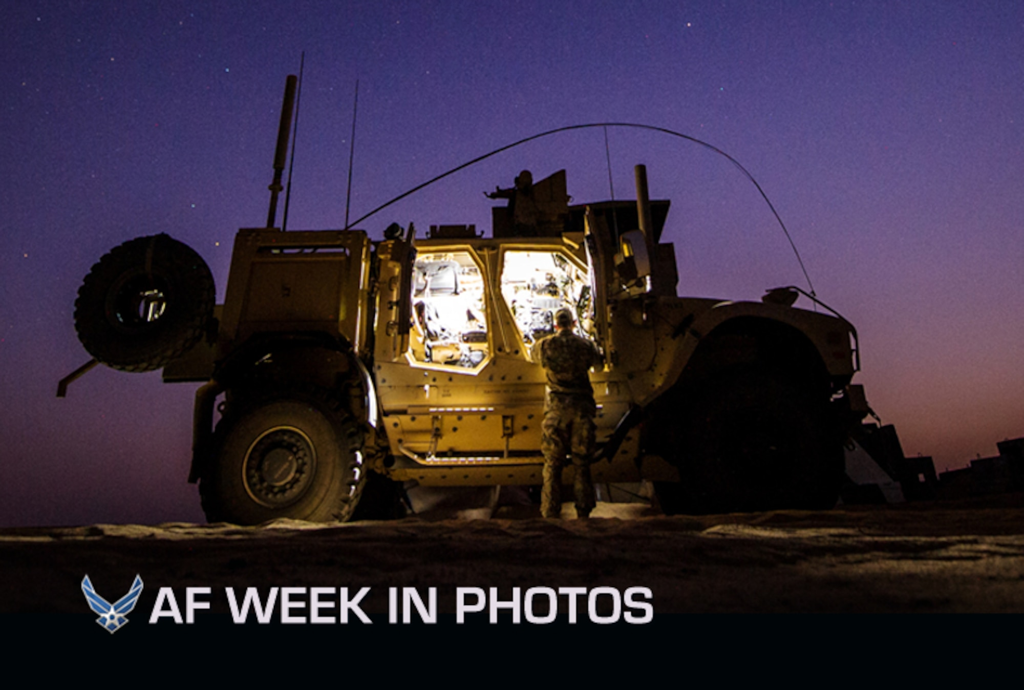 First Lt. Drew Parks grabs equipment from a Mine-Resistant, Ambush-Protected, All-Terrain Vehicle on Sept. 11, 2012, in Southwest Asia. Parks is a joint terminal attack controller with the 82nd Expeditionary Air Support Operations Squadron. (U.S. Air Force photo/Staff Sgt. Jonathan Snyder)