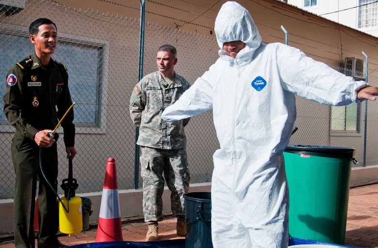 2nd Lt. Nhem Makara (left), prepares to rinse a simulated chemical agent from 2nd Lt.