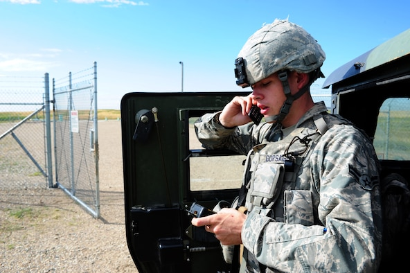 MINOT MISSILE COMPLEX, N.D. -- Airman 1st Class Devin Gorsage (now Senior Airman), 91st Missile Security Forces Squadron response force leader, calls the flight security controller to notify the status of a launch facility. Members of the 91st MSFS provide constant security to national assets located in the missile complex. (U.S. Air Force photo/Senior Airman Michael J. Veloz)