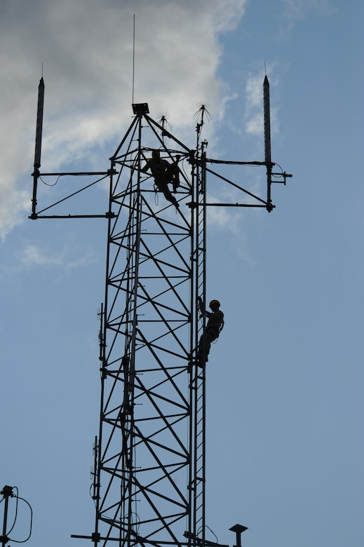Airman 1st Class Creston Jenkins, top, and Senior Airman David Montroy both members of the 2nd Communications Squadron, scale an antenna tower on Barksdale Air Force Base, La., Sept. 18. The Cable Dawgs Airmen climbed the tower to inspect the tower's antennas. Every six months the antennas are inspected to ensure the wires connected to the antennas do not have any corrosion or damage. (U.S. Air Force photo/Senior Airman Micaiah Anthony)(RELEASED)