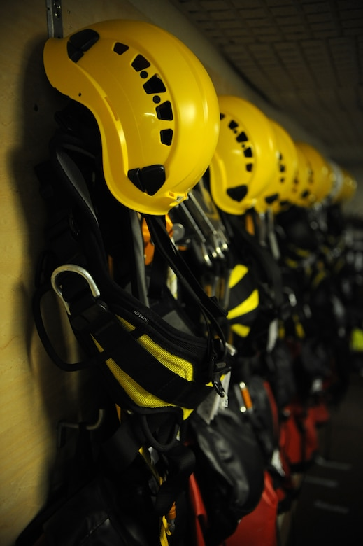 Helmets and safety harnesses line the wall of the 2nd Communications Squadron's Cable Dawgs office on Barksdale Air Force Base, La., Sept. 18. Airmen from 2 CS use harnesses to prevent them from falling when climbing antenna towers. (U.S. Air Force photo/Senior Airman Micaiah Anthony)(RELEASED)