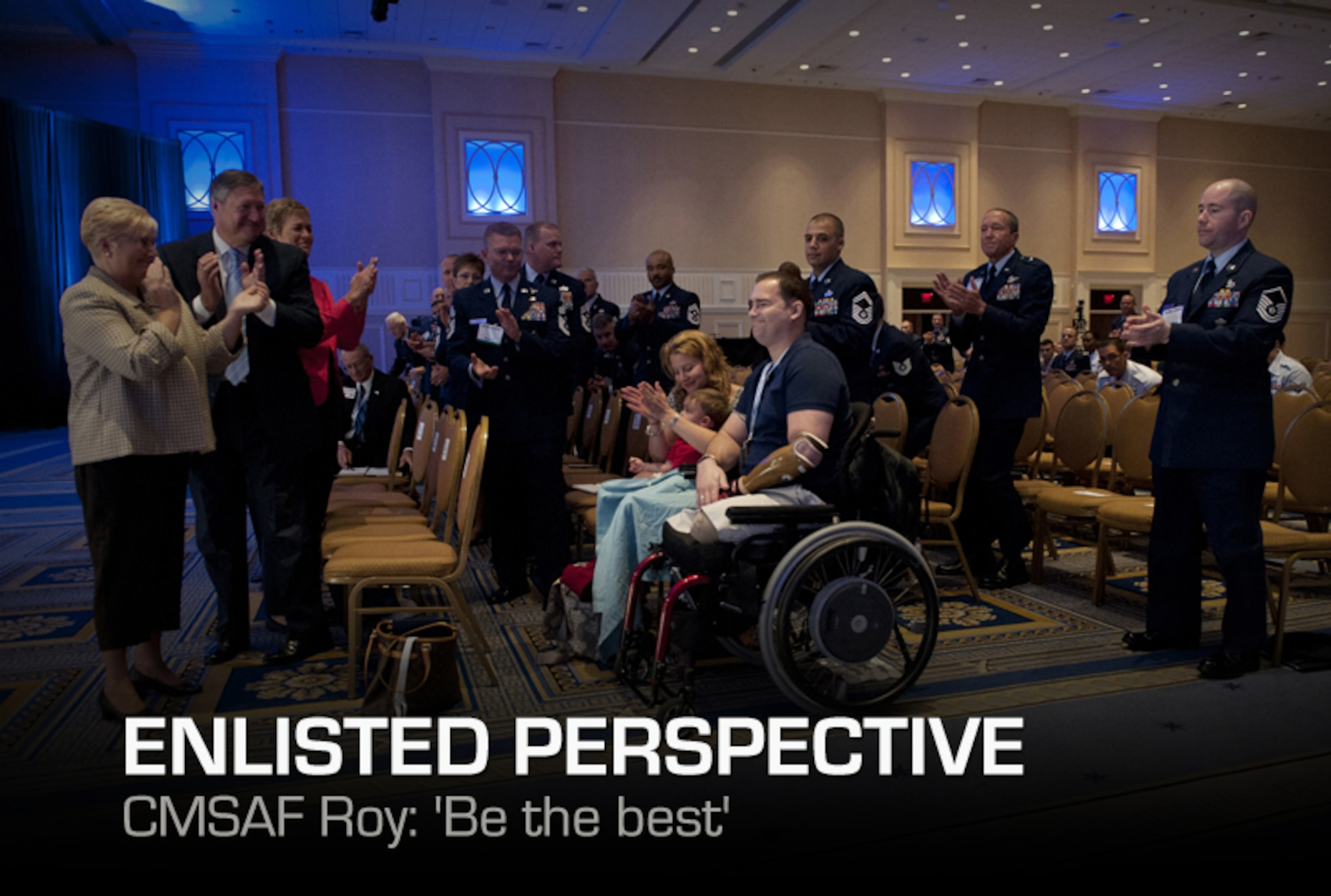 Tech. Sgt. Joe Deslauriers, center, his son, Cameron, and wife, Lisa, are applauded by the crowd during the enlisted call of Air Force Association's Air and Space Conference and Technology Exposition in Washington, Sept. 19, 2012. Deslauriers, who is an explosives ordnance technician assigned to the 1st Special Operations Civil Engineer Squadron, Hurlburt, Fla., lost both legs in Afghanistan last year. To the left is Paula Roy; wife of CMSAF Roy; Secretary of the Air Force Michael B. Donley and his wife, Gail. (U.S. Air Force photo by Val Gempis)