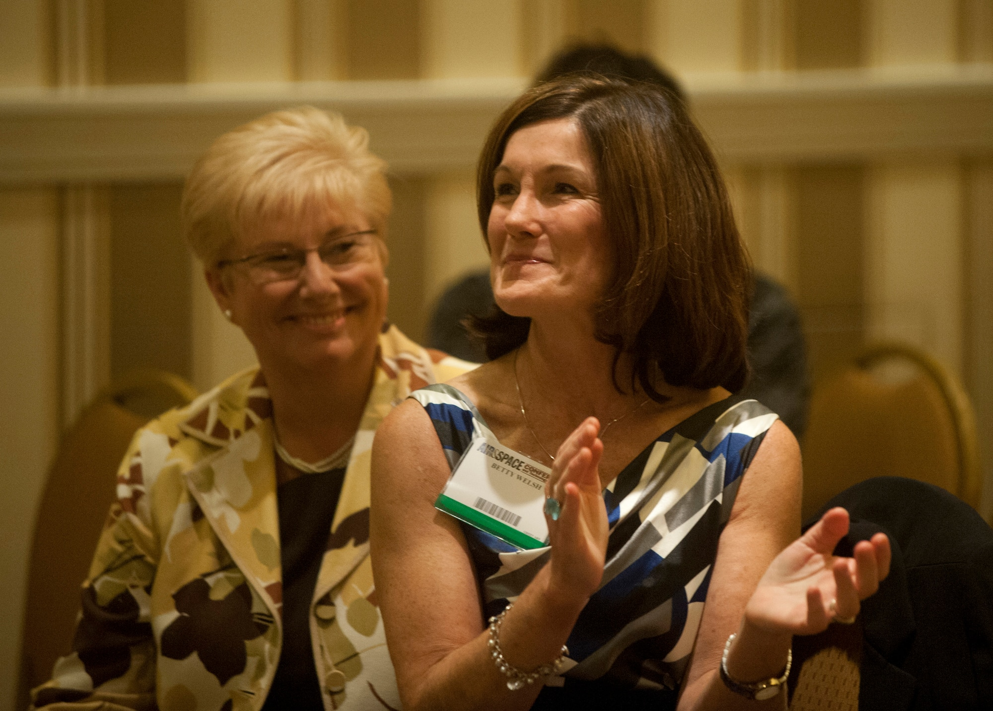 Betty Welsh, wife of Air Force Chief of Staff Gen. Mark A. Welsh III, applauds as she listens to a speaker during the Air Force Association Family Forum in Washington, D.C., Sept. 17, 2012. Beside her is Paula Roy, the wife of Chief Master Sgt. of the Air Force James Roy. (U.S. Air Force photo/Val Gempis)