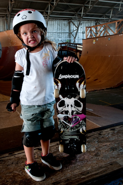 Lindsey Hawk, 5, shows how tough she is while learning to skate on a skateboard Aug. 22 at Joint Base Pearl Harbor Hickam, Hawaii. The converted hangar is the only indoor wooden facility on all the Hawaiian Islands. It also boasts the only wooden keyhole bowls, or empty swimming pool shaped ramps, on Oahu. In addition, it has a 15,000 square foot street course, multiple mini ramps, 12-foot vertical ramp with a 14-foot tombstone connected to a saddle and three-quarter pipe. (U.S. Air Force photo/Staff Sgt. Mike Meares)