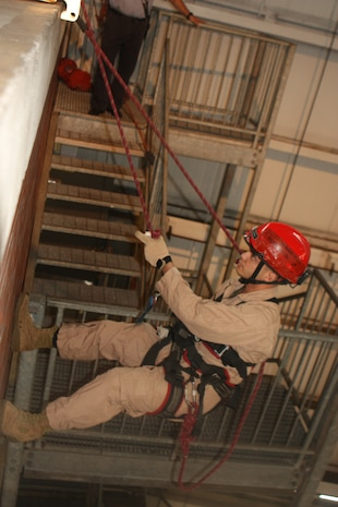 """Randall's Island, NEW YORK –Sergeant Daniel Barbadillo, an extraction Marine with Initial Response Force """"B,""""  prepares to repel down two stories to rescue a """"stranded victim"""" from a ledge and get them safely to the ground. The FDNY has been involved in training the Mariens and sailors of CBIRF since 1997, when Chief Raymond Downey helped expand CBIRF's technical rescue platform."""