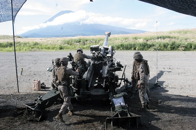Marines from Battery O, 5th Battalion, 14th Marine Regiment, 4th Marine Division prepare to fire artillery rounds from an M777A2 155 mm howitzer at East Fuji Maneuver Area, Japan Sept. 11. Battery O is in Japan as a part of the Unit Deployment Program, a program designed to increase the training level and unit continuity of Marine Corps units stationed in the continental United States. Realistic scenarios and combined exercises are a highlight of the UDP, bringing Marines of many different units together, sometimes with foreign forces. (U.S. Marine Corps photo by Pfc. Terence G. Brady/Released)